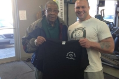 One of our members, John, receiving a free shirt for his dedication!